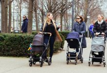 Three mothers pushing strollers in the city, one asking a nosy adoption question