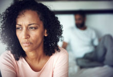 Unhappy black couples in their bedroom are wondering if they should move from fertility treatments to adoption